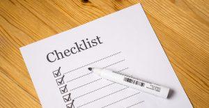 Checklist paper and a pen.