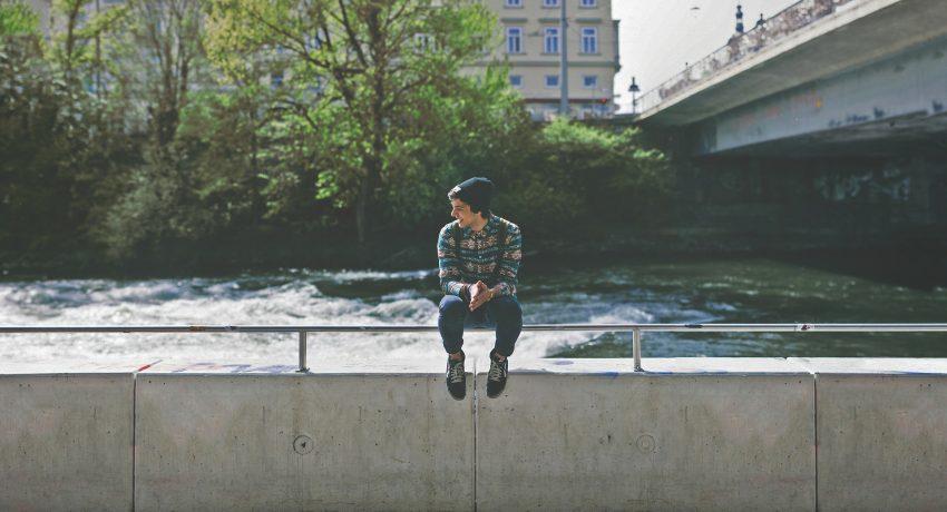 A teen sitting alone.