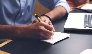 A man writing down a moving plan