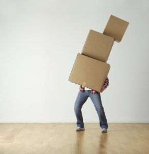 A person carrying boxes.
