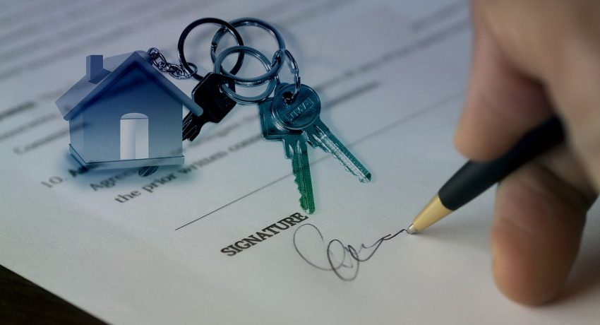 One of the first-time home buyers in NYC signing a contract.
