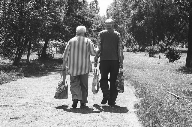 An elderly couple walking and discussing affordable alternatives to Florida to retire to.