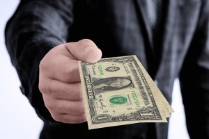 Dollar Hand Giving - 5 ways to avoid moving scams in 2020