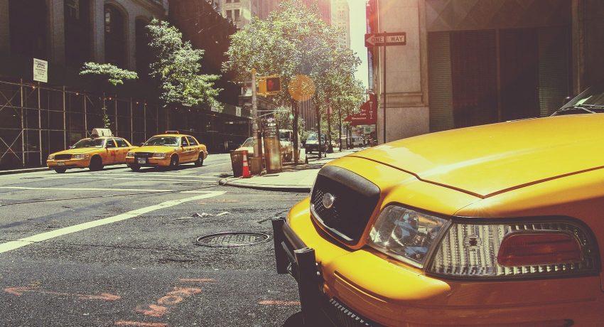 Yellow cabs in a street of one of the best Queens neighborhoods.