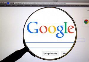 Google search engine through a magnifying glass.