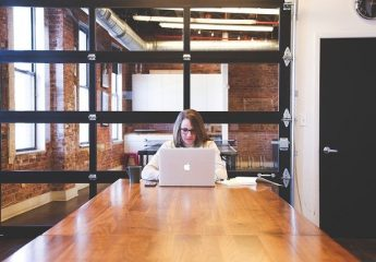 A girl researching arts of Silver Spring for your new office space.