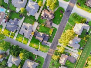 A birdseye view of a suburban area which is a huge part of TX real estate.