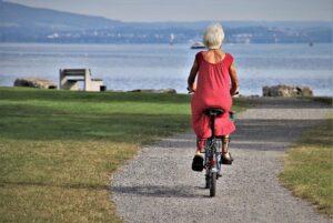 A senior riding a bike.