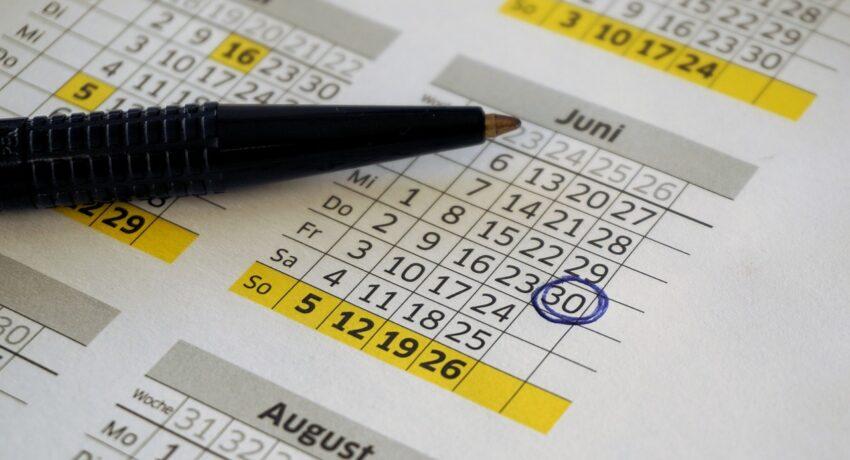A calendar and a pen