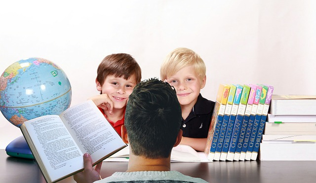 Teacher working with two boys