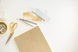 Scissors, paper, some pencils.