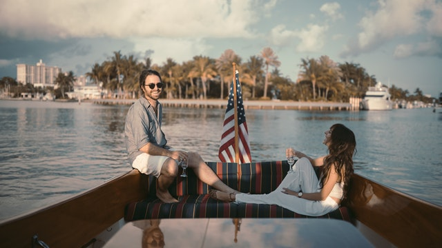 A couple on aboat talking about moving to Florida.
