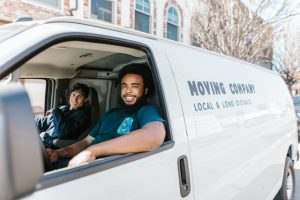 Two men sitting in a moving truck