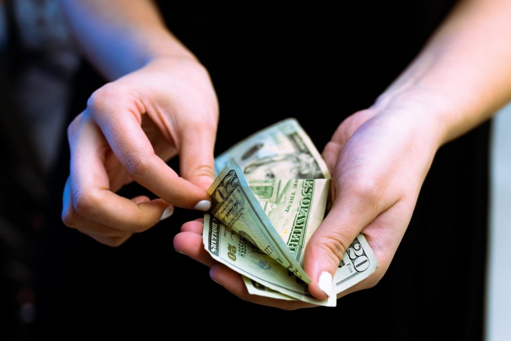 A man holding some money