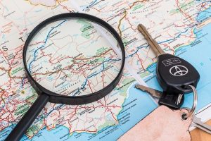 Map, keys and magnifying glass