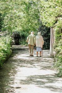 An elderly couple walking.