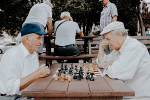 Two seniors playing chess in one of the senior communities in Pennsylvania.