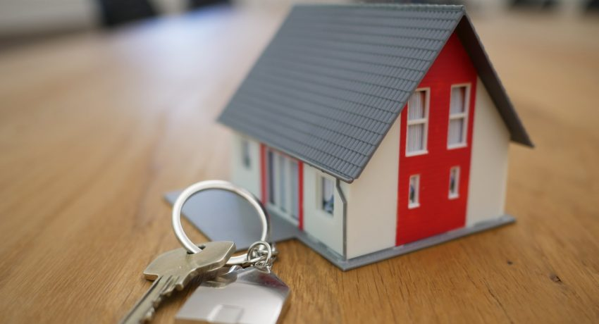 House -shaped key ring and a key