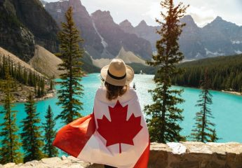 a woman wearing a Canadian flag, read about How to stage a Canadian house for American buyers